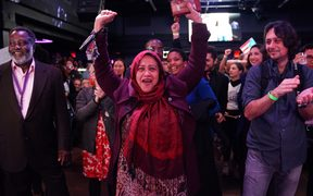 Supporters of Democrat Alexandria Ocasio-Cortez cheer during her election night party in New York.