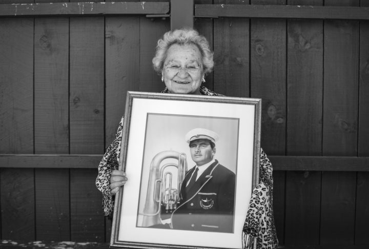Henei with a picture of her  late husband Joe Reti.