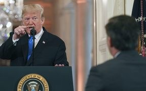 US President Donald Trump points to CNN journalist Jim Acosta during a post-election press conference in the White House.