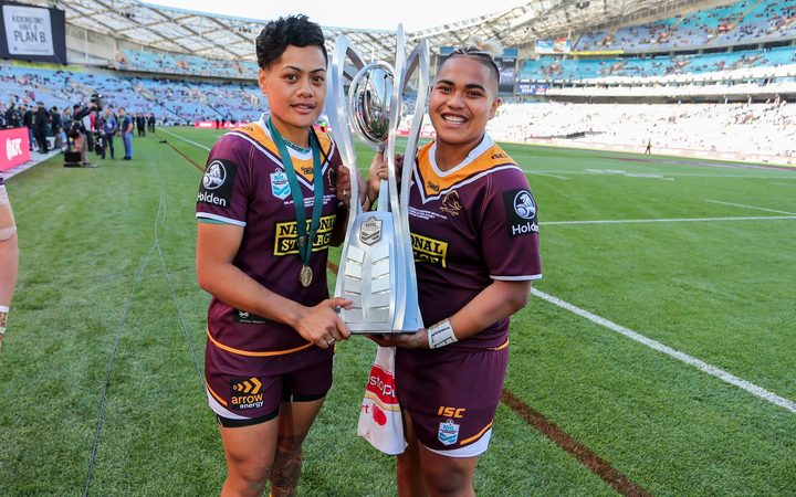 Kimiora Nati and Ngatokotoru Arakua with the Holden Premiership Trophy after the Broncos beat the Roosters.