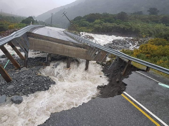 A bridge to Arthur's Pass collapsed after heavy rainfall lashed the West Coast region.
