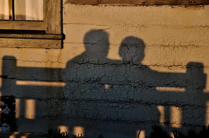 shadow of two people talking