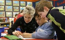 A teacher working with pupils at Omata School, New Plymouth.