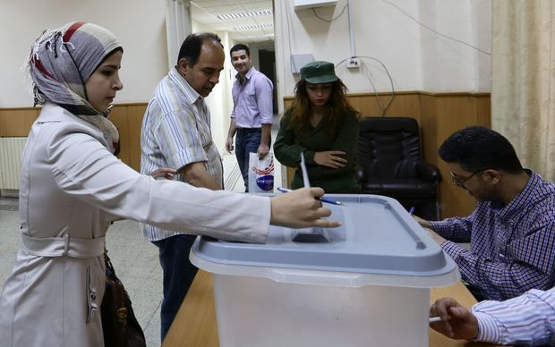 A woman casts her ballot at a polling station in central Damascus.