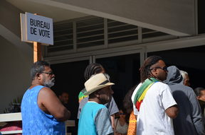 Voters on New Caledonia's restricted roll line up in 2018 independence referendum