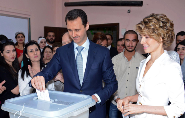 President Bashar al-Assad and wife Asma al-Assad casting their votes at a polling station in Maliki.
