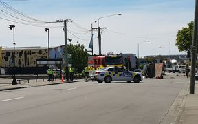 A four wheel drive lying on its side after it collided with a motorbike at the intersection of Colombo Street and Sandyford Street in Christchurch.