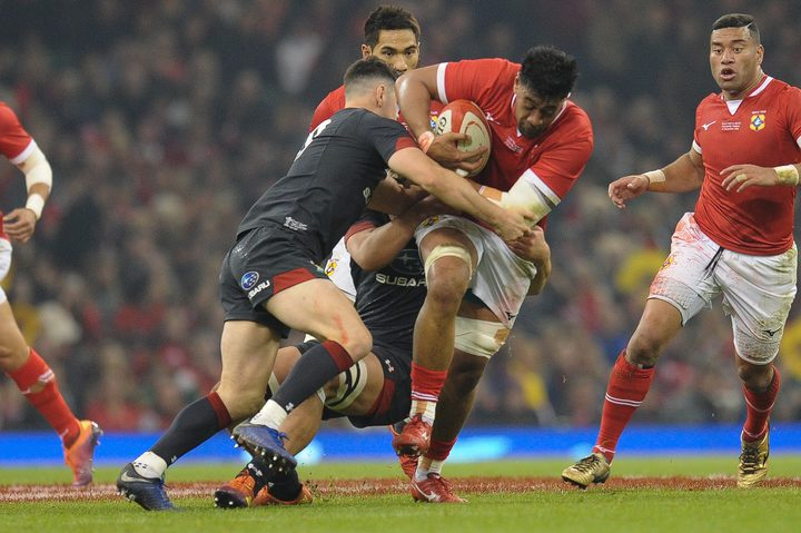 Tonga's Dan Faleafa is tackled by Tomos Williams during the 74-24 defeat in Cardiff.