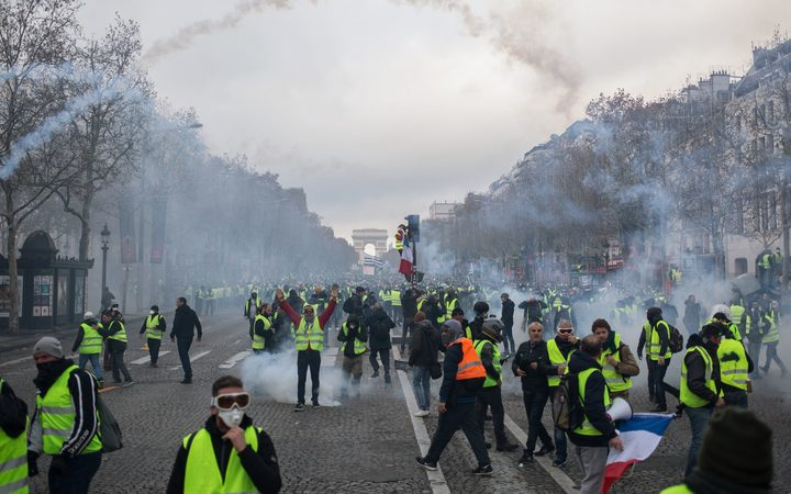 france fuel protests police in paris fire tear gas rnz news