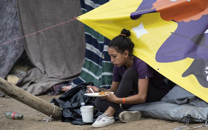 A Central American migrant at a temporary shelter in Tijuana, Mexico.