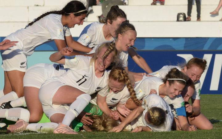 New Zealand players celebrate after defeating Japan in a penatly shoot-out during their FIFA U-17 Women's World Cup Uruguay 2018 quarter-final football match.