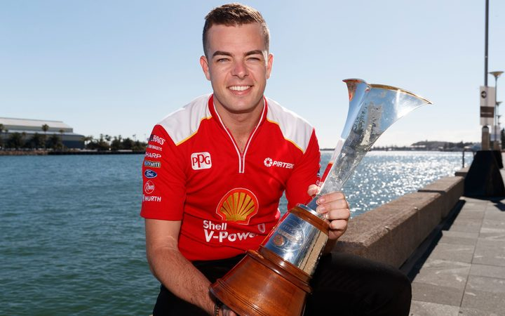 Kiwi driver Scott McLaughlin with the Supercars championship trophy after his 2018 title triumph.