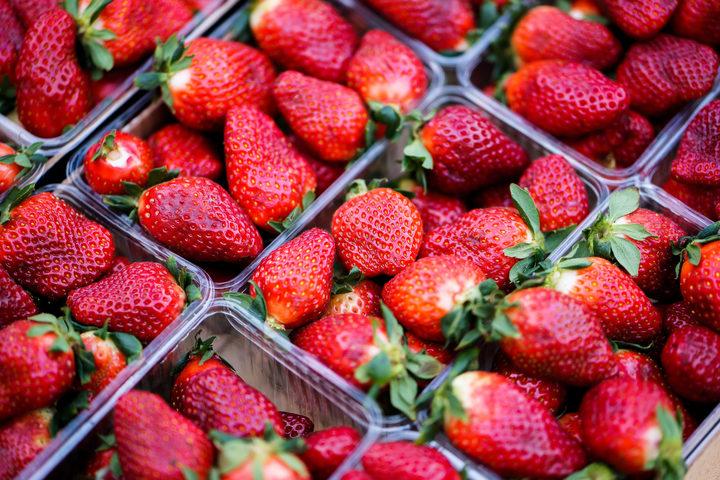 Strawberries in plastic container.