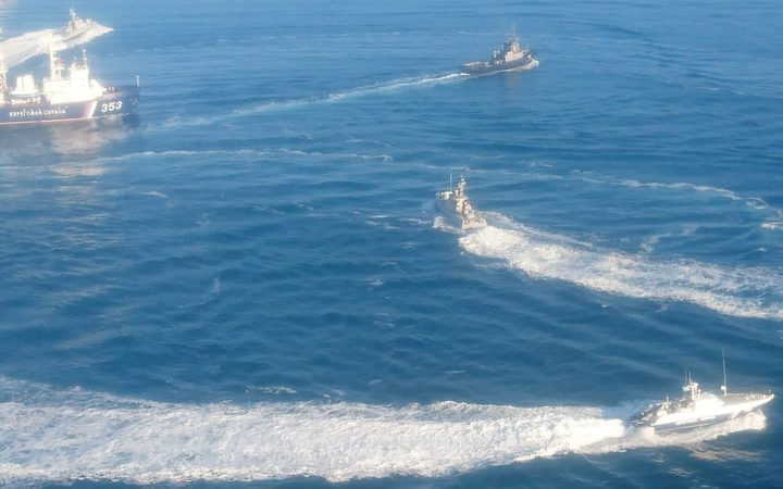 In this handout photo distributed by the Russian Federal Security Service, three Ukrainian naval ships cross the Russian border, entering temporarily closed area of the Russian territorial waters and heading from the Black Sea to the Kerch Strait in Russia, November 25, 2018.