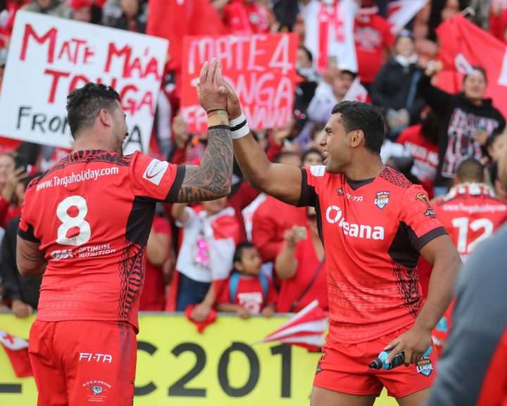 Tonga's Andrew Fifita and Tevita Pangai Junior celebrate their upset win over the Kiwis at the 2017 World Cup.