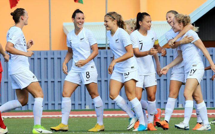 Paige Satchell and Football Ferns team celebrate her goal.