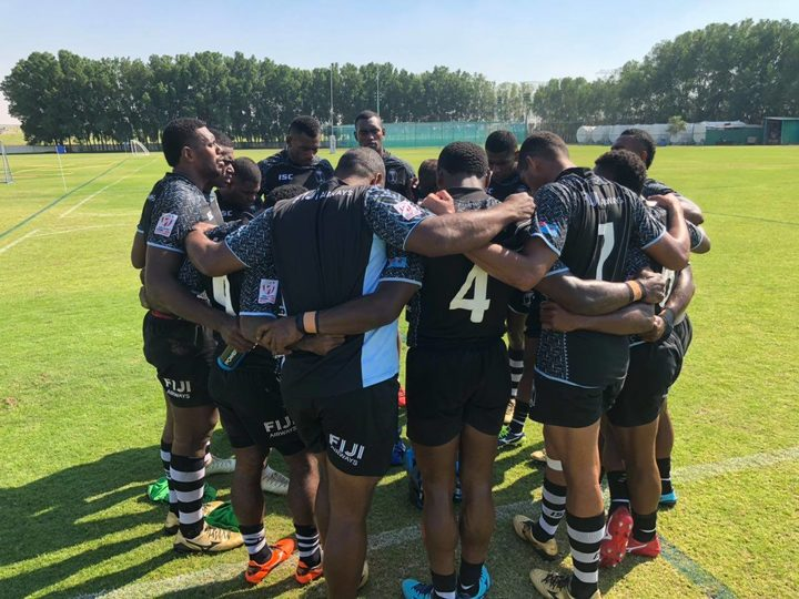 The Fiji sevens team huddle together during a training session in Dubai
