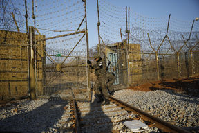 South Korean soldiers open the gate as the rails which leads to North Korea is seen, inside the demilitarized zone separating the two Koreas in Paju.