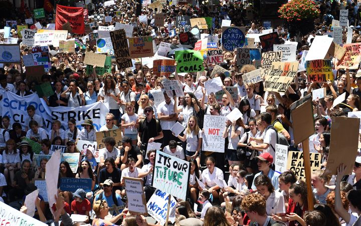 Students from different schools raise placards during a protest rally for climate change awareness at Martin Place in Sydney
