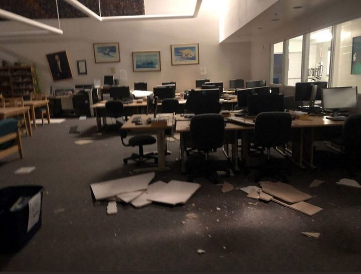 Books and ceiling tiles litter the floor at the The Mat-Su College library in Anchorage Alaska