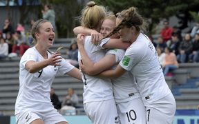 New Zealand's Grace Wisnewski (2-R) celebrates with teammates after scoring against Canada in the U-17 Women's World Cup football match for the third place in Montevideo.