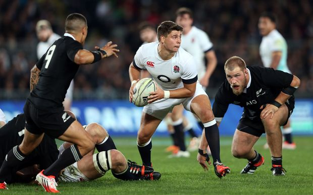 England's Ben Youngs passes the ball near All Blacks Aaron Smith (left) and Owen Franks (right).
