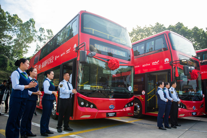 Bus drivers and stewardesses with new BYD electric double-decker buses in Shenzhen city. The 16,000 buses in the southern city was 100 percent electric by the end of 2017. BYD became the world's biggest manufacturer of electric vehicles in 2016, exporting to 50 countries.