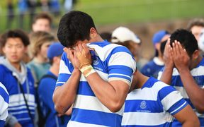 Disappointed St Kentigern's College players bury their heads in their hands after losing to St Peter's in the semi-finals of the Auckland College 1st XV competition.