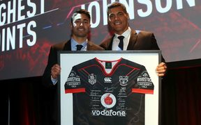 Shaun Johnson and Stephen Kearney celebrate a milestone for the star playmaker.