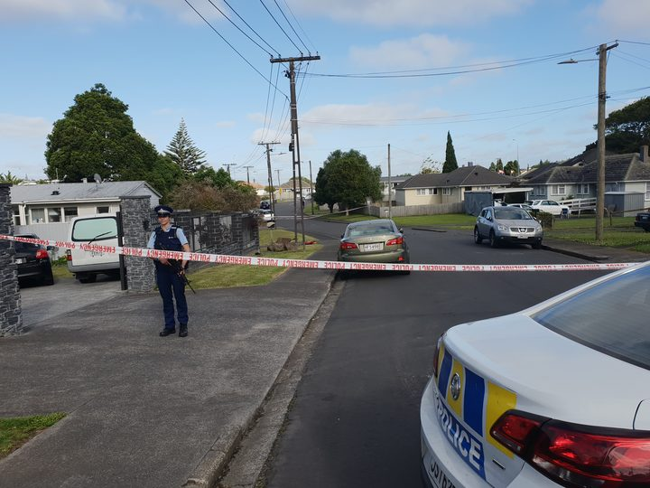 Armed police are protecting a large cordon in Mt Roskill where a person was stabbed and killed last night.