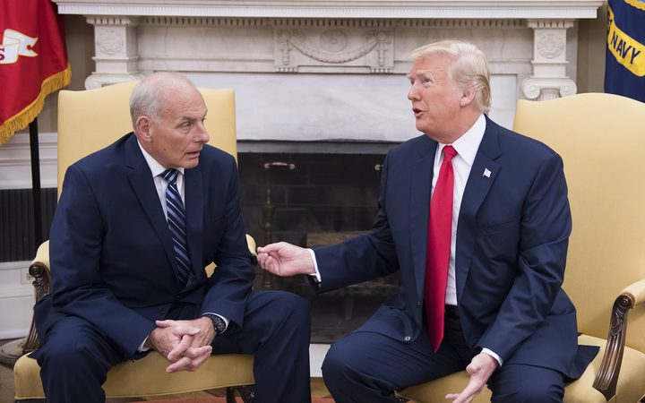 US President Donald Trump (R) speaks with White House Chief of Staff John Kelly