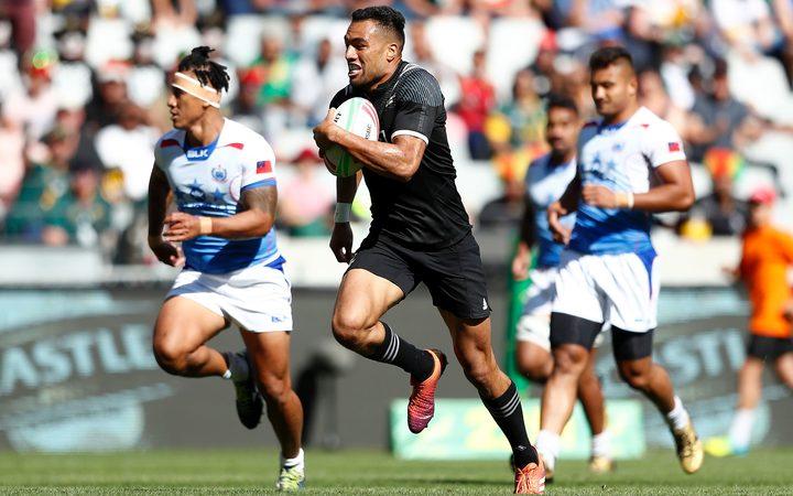 New Zealand's Sione Molia runs in to score against Samoa in Cape Town.