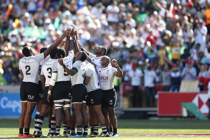 Fiji huddle before their semi final against South Africa.