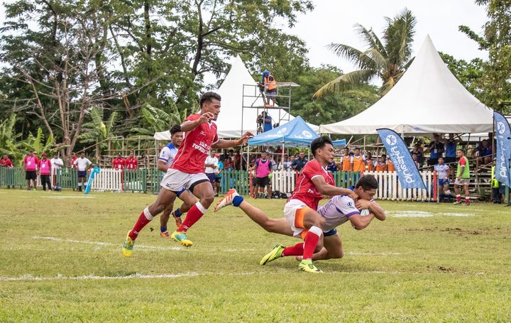 Tonga held off Samoa to qualify for the World Rugby Under 20 Trophy.