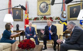 Donald Trump (C) US House Speaker-designate Nancy Pelosi (L) and US Senate Minority Leader Chuck Schumer (R) argue as US Vice President Mike Pence (2-L) looks on. White House, 11 December 2018.