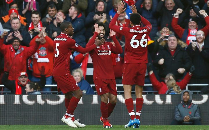 Mohamed Salah of Liverpool celebrates with his team mates after he scores.