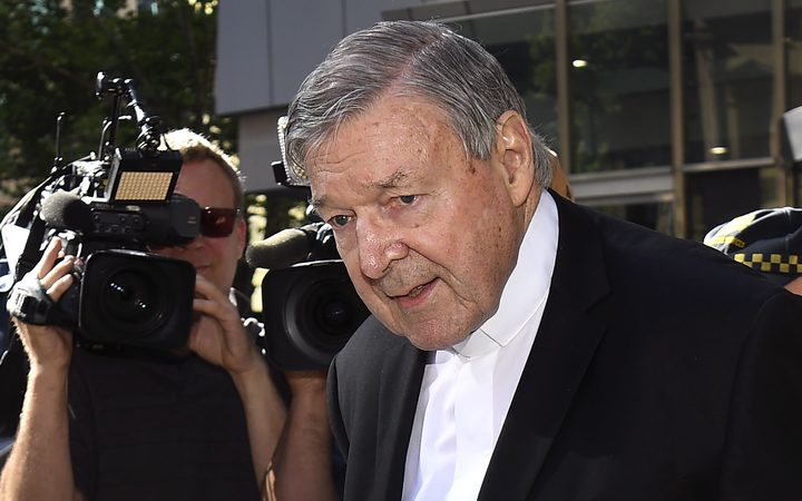 Cardinal George Pell walks to a car in Melbourne on December 11, 2018
