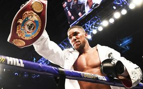 Anthony Joshua holds up the WBO belt that was held by Joseph Parker.