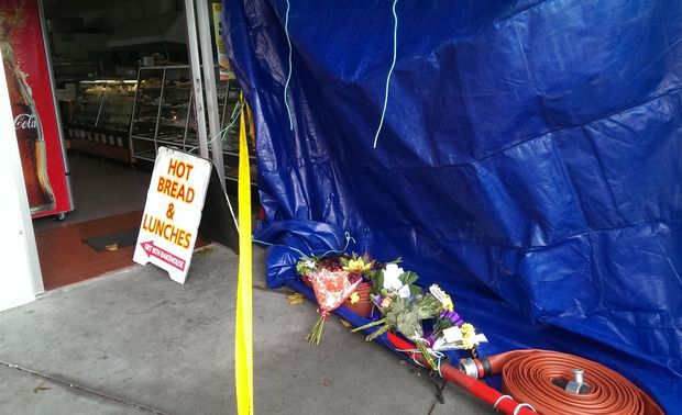 Flowers placed outside the dairy owned by Arun Kumar.