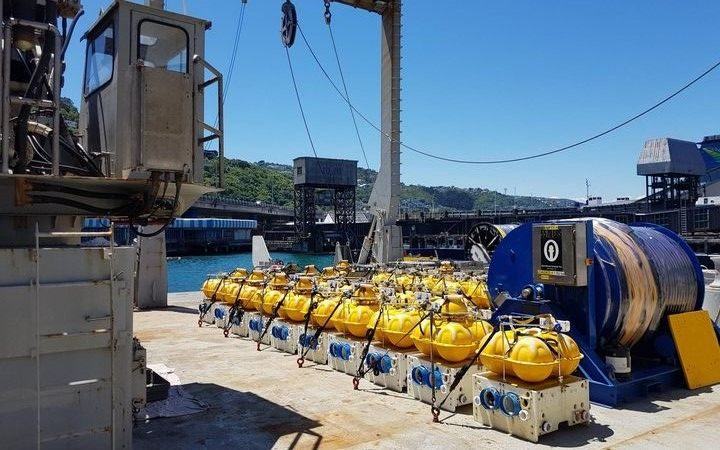 The floats being deployed on the sea floor to study New Zealand's subduction zone.