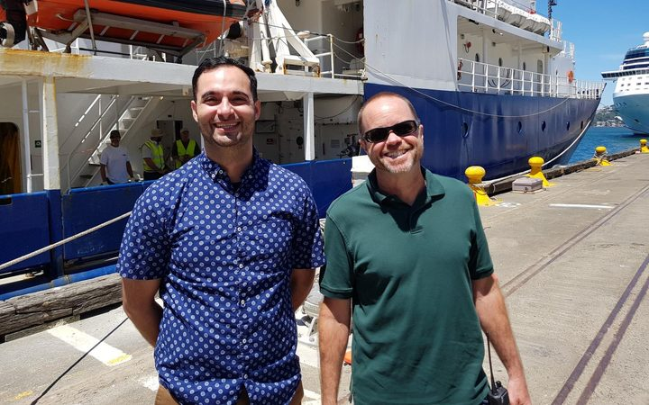 Dr Samer Naif, left, with the captain of  the US research ship Roger Revelle.