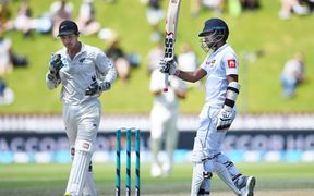 Sri Lanka's Kusal Mendis celebrates his 50 on day 4 of the first cricket Test against NZ.