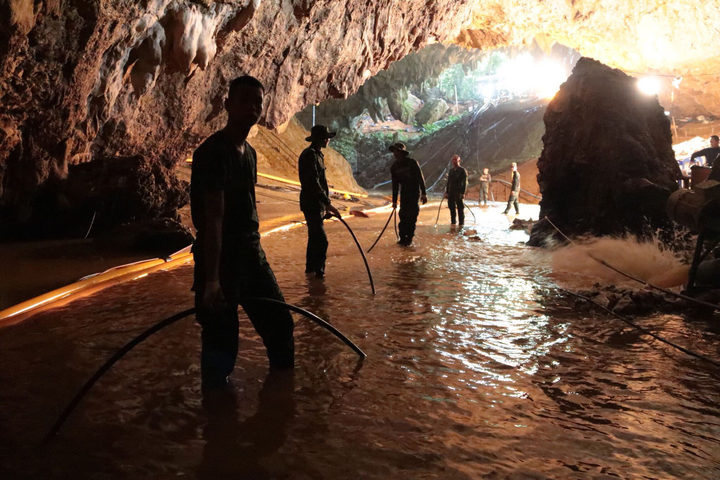 Thai Navy soldiers in the flooded Tham Luang cave during rescue operations for the 12 boys and their football team coach trapped in the cave at Khun Nam Nang Non Forest Park.