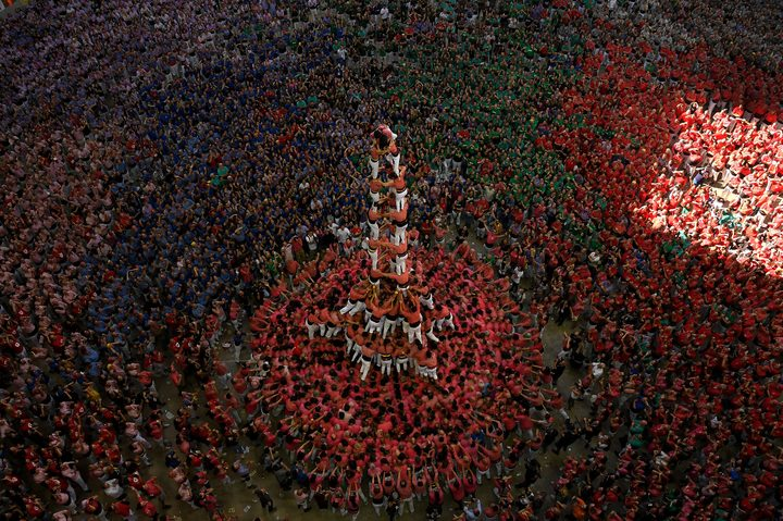 "Members of the ""Colla Vella dels Xiquets de Valls"" human tower team form a ""castell"" (human tower) winning the XXVII 'castells' competetion in Tarragona on October 7, 2018."