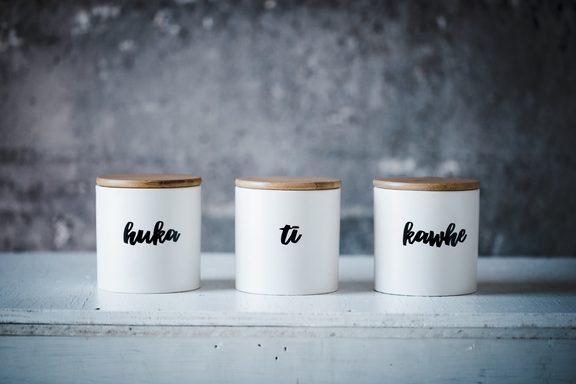 Taputapu sells household items like mugs and containers with te reo Māori labels on them