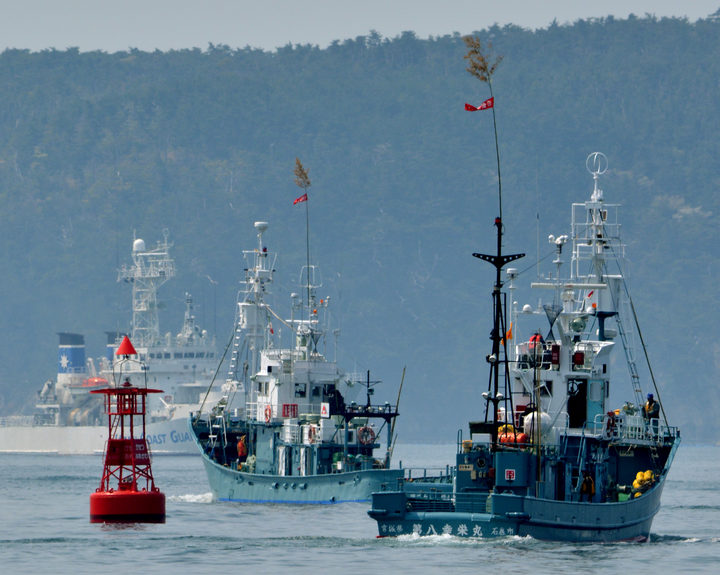 Japanese whaling fleets depart Ayukawa port in Ishinomaki City on April 26, 2014 under under tight security by the Japan Coast Guard. AFP PHOTO / KAZUHIRO NOGI