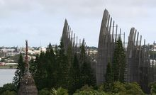 New Caledonia's Jean-Marie Tjibaou Cultural Centre meets the outer Noumea skyline.
