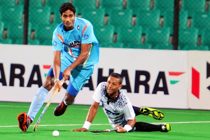 Fiji men's captain Hector Smith Junior puts his body on the line against India during the World League Round 2 match in New Delhi in 2013.