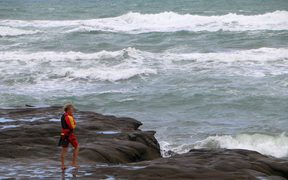 A lifesaver on Muriwai's flat rock.