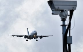 An aircraft prepares to land at London Gatwick Airport after flights resumed following the closing of the airfield due to sightings of drones.